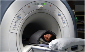 Child being placed in MRI scanner