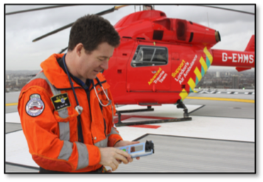 Medical emergency helicopter and pilot next to it