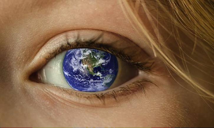 Female eye with globe overlaying the iris